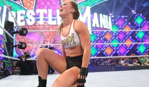Ronda Rousey impresses in her WWE in ring debut