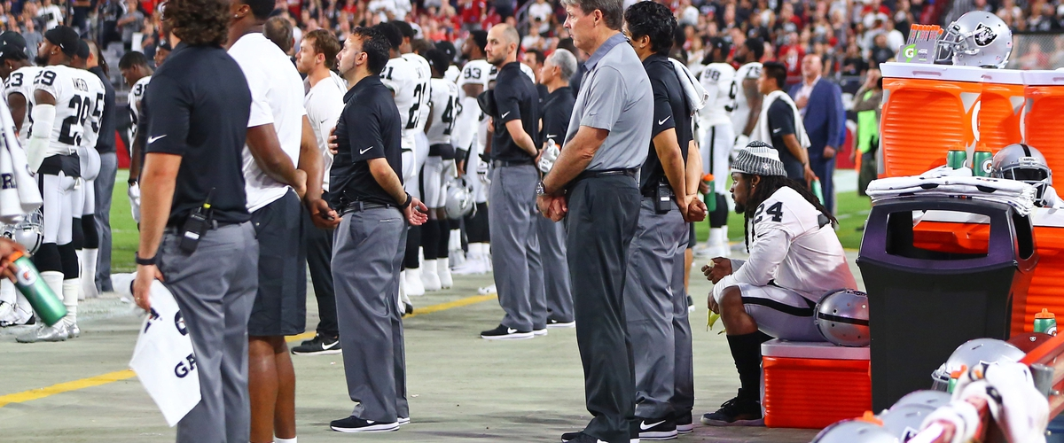 Marshawn Lynch sits during the National Anthem