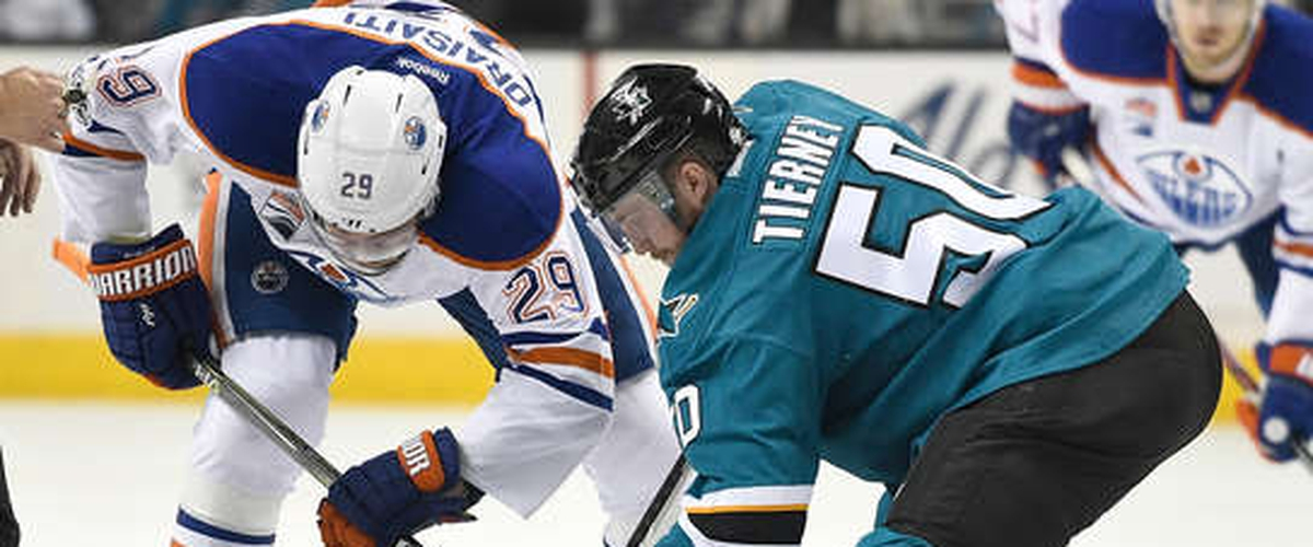 Oilers Draisaitl takes faceoff vs Sharks Tierney.jpg