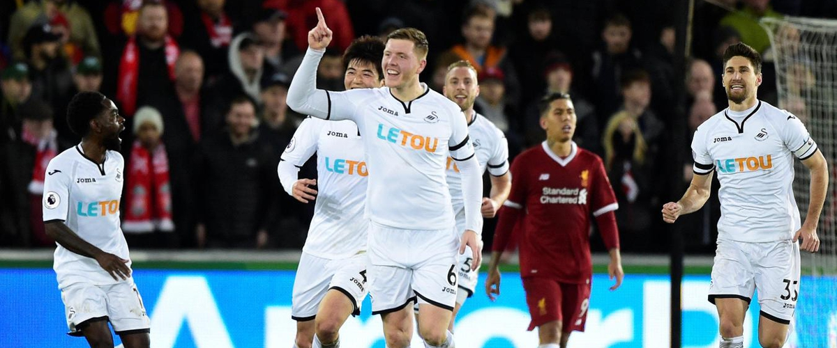 Liverpool vs Swansea : Liverpool's unbeaten record ended by Swansea