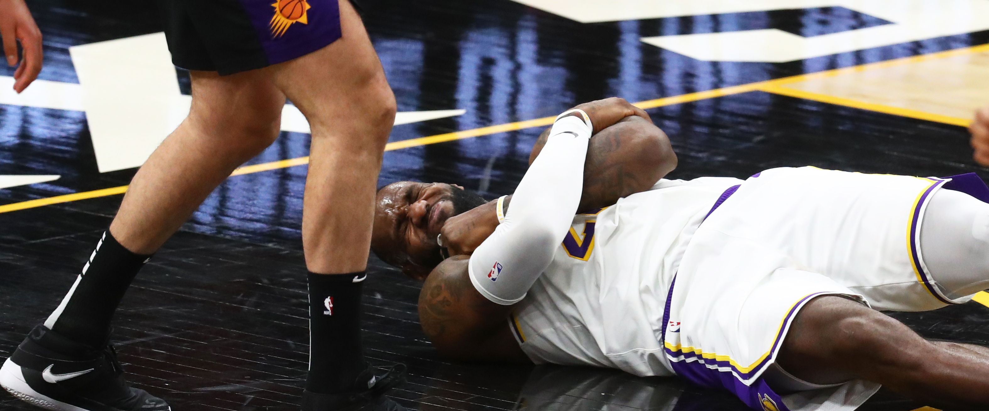 WATCH: LeBron James fakes injury; demands attention