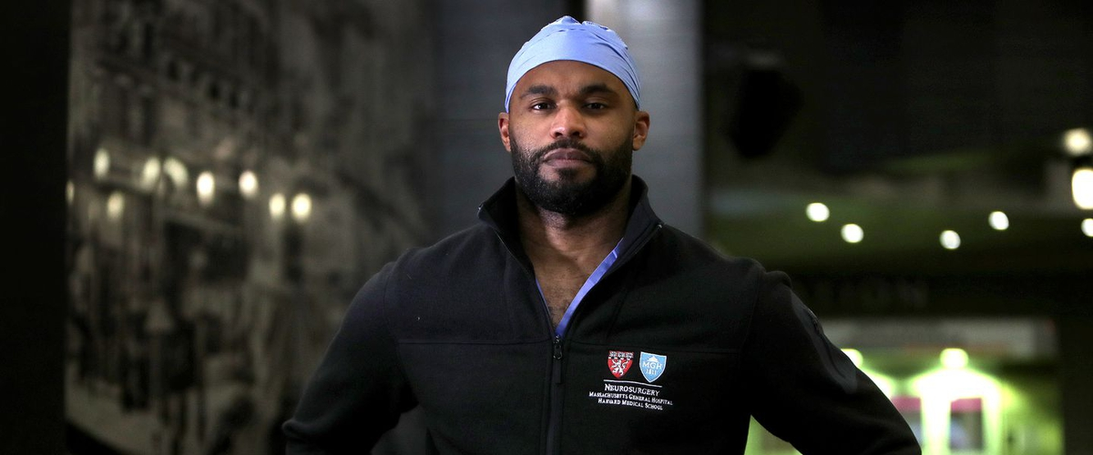 Former Titan Myron Rolle has exchanged the helmet for the surgical mask